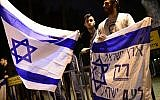 Right-wing Jewish activists protest outside a joint ceremony for families of Israeli and Palestinian victims on Israeli Memorial Day, in Tel Aviv on April 21, 2015. The flag reads 'The land of Israel only for the people of Israel'. (Tomer NeubergFlash90)