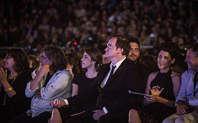 Director Quentin Tarantino and his then-fiance, Daniella Pik, with Cinematheque director Noa Regev to Tarantino's right, at the opening night of the 2016 Jerusalem Film Festival (Hadas Parush/Flash 90)