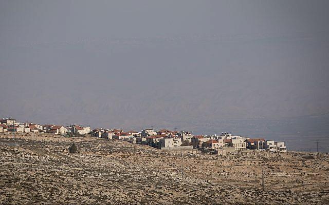 View of the  settlement of Adam (Geva Binyamin), in the West Bank, as seen from the Jewish neighborhood of Neve Yaakov in Jerusalem, January 1, 2017 (Yonatan Sindel/Flash90)