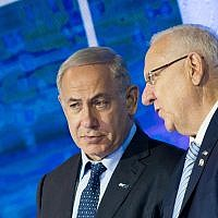 Prime Minister Benjamin Netanyahu speaks with President Reuven Rivlin during the Israel Prize ceremony at the International Conference Center in Jerusalem on May 2, 2017. (Yonatan Sindel/Flash90)