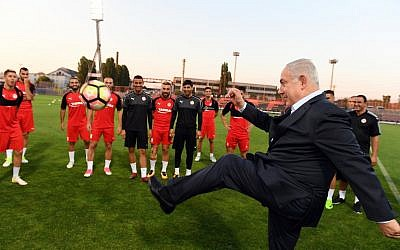 Prime Minister Benjamin Netanyahu visits Hapoel Be'er Sheva soccer club ahead of their game against Budapest Honvéd FC in Budapest, Hungary on July 18, 2017. (Haim Zach/GPO)
