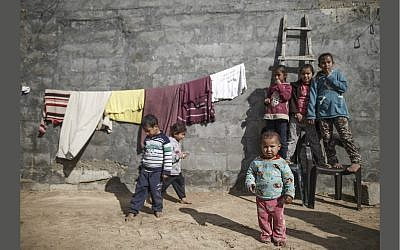 Palestinian refugee children seen inside their family's house in an impoverished area in Gaza City on January 17, 2018. (Flash90/Wissam Nassar)