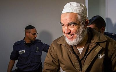 Sheikh Raed Salah, leader of the Northern Branch of the Islamic Movement in Israel, arrives for a hearing at the Haifa Magistrate's Court on February 26, 2018. (Flash90)