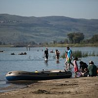 Illustrative photo of Israelis enjoying the beaches of the Sea of Galilee, northern Israel, on April 1, 2018. (Hadas Parush/Flash90)