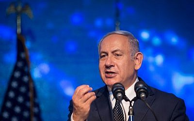 Prime Minister Benjamin Netanyahu speaks during an American Independence Day celebration Airport City, on July 3, 2018. (Miriam Alster/Flash90)
