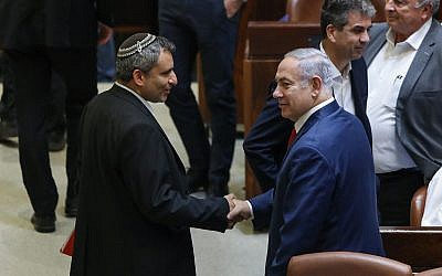 Prime Minister Benjamin Netanyahu (r) seen with Jerusalem and Heritage Minister Ze'ev Elkin in the Knesset in Jerusalem on July 3, 2018. (Noam Revkin Fenton/Flash90)