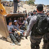 Israeli policemen scuffle with Palestinian demonstrators in the Bedouin village of al-Khan al-Ahmar  on July 4, 2018July 4, 2018. (Flash90)