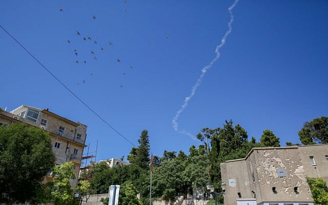 A smoke trail of a Patriot missile that intercepted a Syrian drone that entered Israeli airspace from Syria, as seen over the northern Israeli city of Safed on July 11, 2018. (David Cohen/Flash90)