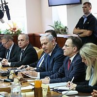 Prime Minister Benjamin Netanyahu leads the weekly government meeting at the Prime Minister's Office in Jerusalem on July 15, 2018 (Alex Kolomoisky/POOL)