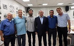 Prime Minister Benjamin Netanyahu, 3rd from right, meets with heads of local authorities from the Gaza Strip border communities during a visit to Sderot on July 16, 2018. (Haim Zach/GPO)