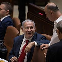 Prime Minister Benjamin Netanyahu with cabinet ministers at the Knesset plenum on July 18, 2018 (Hadas Parush/Flash90 )