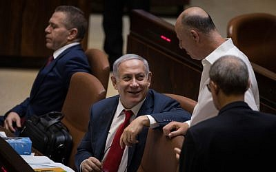 Prime Minister Benjamin Netanyahu (C) with cabinet minister Tzachi Hanegbi (CR) at the Knesset plenum on July 18, 2018 (Hadas Parush/Flash90 )