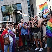 Members of the LGBT community demonstrate   in Tel Aviv against a Knesset legislation that denies surrogacy rights for same-sex couples on July 18, 2018. (Miriam Alster/Flash90)