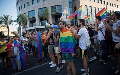 Members of the LGBT community and supporters participate in a demonstration against a Knesset bill amendment denying surrogacy for same-sex couples, in Tel Aviv on July 18, 2018. (Miriam Alster/Flash90)