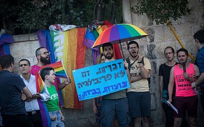 Members of the LGBT community and supporters participate in a demonstration against a Knesset bill amendment denying surrogacy for same-sex couples, outside Prime Minister's Residence in Jerusalem on July 18, 2018. (Yonatan Sindel/Flash90)