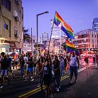 Members of the LGBT community and supporters participate in a demonstration against a Knesset bill amendment denying surrogacy for same-sex couples, Tel Aviv on July 19, 2018 (Tomer Neuberg/Flash90)