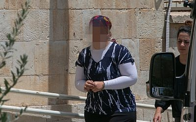 An ultra-Orthodox woman is brought to the Jerusalem Magistrate's Court, on July 3, 2018, under charges of abusing her children by injecting them with insulin to making false claims of diabetes for National Insurance money. (Yonatan Sindel/Flash90 )