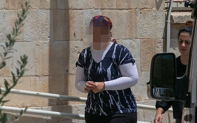 An Ultra Orthodox woman is brought to the Jerusalem Magistrate's Court, on July 3, 2018, under charges of abusing her children by injecting them Insulin to making false claims of diabetes for National Insurance money. (Yonatan Sindel/Flash90 )