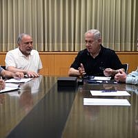 Prime Minister Benjamin Netanyahu (center), Defense Minister Avigdor (left) Liberman and IDF Chief of Staff Gadi Eisenkot (right) seen during an emergency meeting at the Ministry of Defense in Tel Aviv, on July 20, 2018 (Ministry of Defense/Ariel Hermoni)