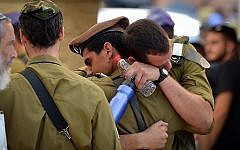 Friends and family attend the funeral of IDF Sgt Aviv Levi of the Givati Brigade in Petach Tikva on July 22, 2018. (Avi Dishi/FLASH90)