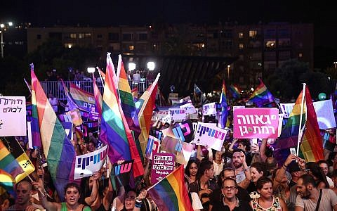 Members of the LGBT community and supporters participate in a protest against a Knesset bill amendment denying surrogacy for same-sex couples, at Rabin Square in Tel Aviv on July 22, 2018. (Miriam Alster/Flash90)