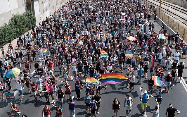 Protesters for LGBT rights march on Tel Aviv's Ayalon freeway, July 22, 2018. (Tomer Neuberg/Flash90)