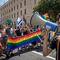Members of the LGBT community and supporters participate in a demonstration against a Knesset bill amendment denying surrogacy for gay men, in Jerusalem on July 22, 2018.  (Yonatan Sindel/Flash90)