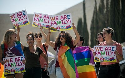 Illustrative image of members of the LGBT community and supporters participating in a demonstration against a Knesset bill amendment denying surrogacy for same-sex couples, outside the supreme court in Jerusalem on July 23, 2018. (Yonatan Sindel/Flash90)