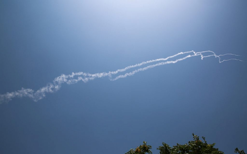Smoke trails from two Israeli Patriot interceptor missiles that Israel says shot down a Syrian fighter jet are seen in northern Israel on July 24, 2018. (David Cohen/Flash90)