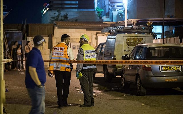 IParamedics and security forces at the scene of a stabbing attack in the West Bank ( Hadas Parush/Flash90)