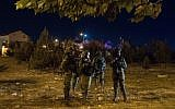 Israeli security forces are seen at the scene of a stabbing attack in the West Bank settlement of Adam on July 26, 2018. (Hadas Parush/Flash90)