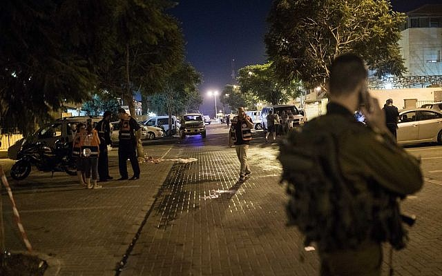 Israeli security forces at the scene of a stabbing attack in the West Bank settlement of Adam