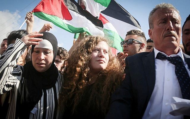 Palestinian teenager Ahed Tamimi (c) is welcomed by relatives and supporters after she was released from Israeli military prison on July 29, 2018. (FLASH90)