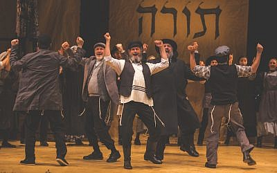"Steven Skybell, center, as Tevye and ensemble in the National Yiddish Theatre Folksbiene's production of ""Fiddler on the Roof."" (Victor Nechay/ProperPix via JTA)"