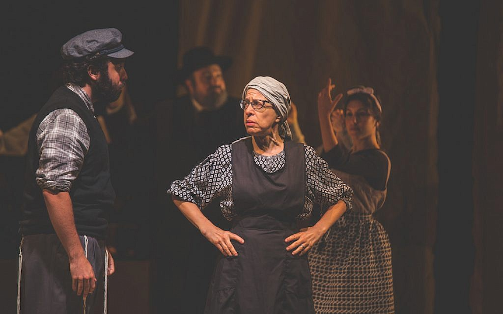 """Kirk Geritano, left, and Jackie Hoffman in a scene from the Folksbiene's """"Fiddler on the Roof."""" (Victor Nechay/ProperPix via JTA)"""