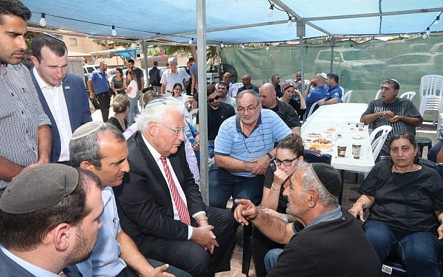 US Ambassador David Friedman pays a condolence visit to the family of Yotam Ovadia who was killed in a terror attack in the West Bank Settlement of Adam, July 30, 2018. (Miri Tzahi/Yesha Council)