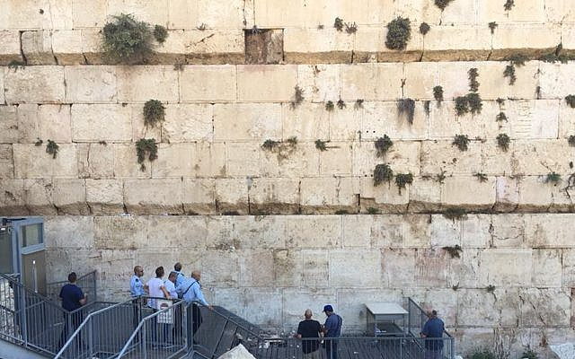 Israel Antiquities Authority professionals assess damage at the Robinson's Arch section of the Western Wall after a stone fell on July 23, 2018. (Hannah Estrin)