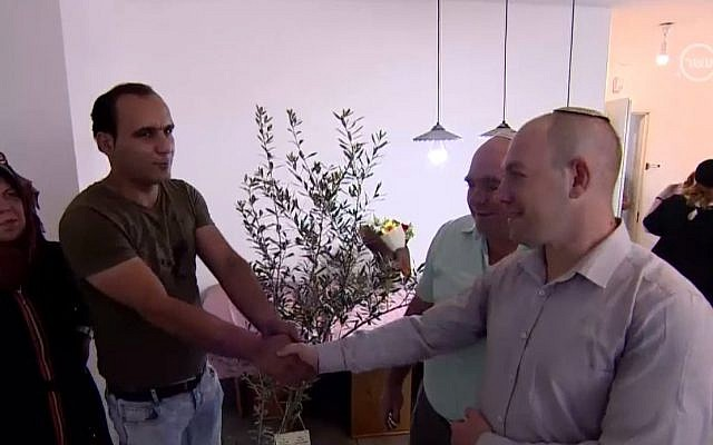 Palestinian Abed, left, meets with Ariel Bir, an Israeli settler who he saved, along with his family, from their car following a road accident. (Channel 10)