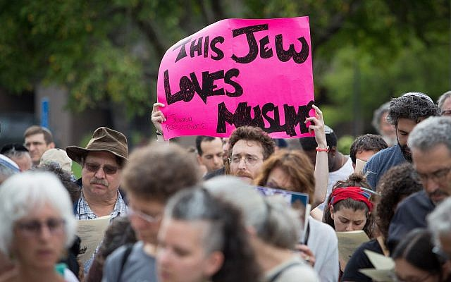 In Burlington, Massachusetts, more than 200 protesters gather outside the government's ICE offices to demand an end to the Trump Administration's immigration policies, July 22, 2018 (Elan Kawesch/The Times of Israel)