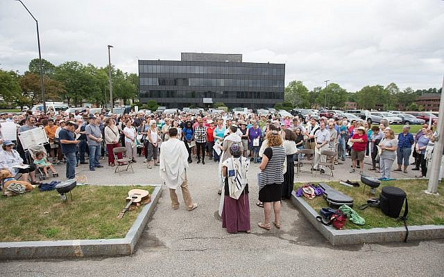 In Burlington, Massachusetts, more than 200 protesters gather outside the government's local ICE offices, July 22, 2018 (Elan Kawesch/The Times of Israel)