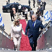 Illustrative: Prime Minister Benjamin Netanyahu (R) and his wife Sara boarding a plane at Ben Gurion Airport before departing to Moscow, Russia, on July 11, 2018. (Kobi Gideon/GPO)