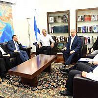 Prime Minister Benjamin Netanyahu (center-right) meets with Finance Minister Moshe Kahlon (center-left), Communications Minister Ayoub Kara (3rd-left), Tourism Minister Yariv Levin (2nd-left), Kulanu MK Akram Hasson (left), Yisrael Beytenu MK Hamad Amar (right), Defense Minister Avigdor Liberman (2nd-right) and his chief of staff Yoav Horowitz (3rd-right) on July 26, 2018. (Haim Tzach/GPO)
