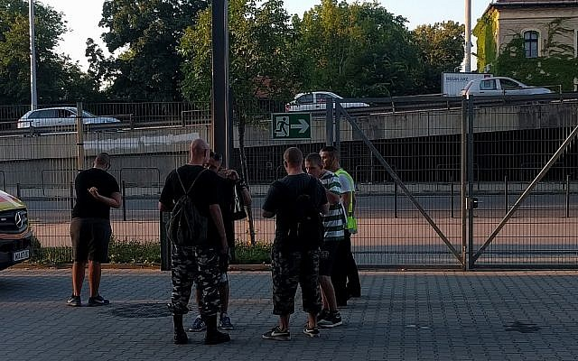 Men in boots and fatigues outside Groupama Arena in Budapest, during a match between the Ferencvaros Torna and Maccabi Tel Aviv clubs, July 12, 2018. (Yaakov Schwartz/ Times of Israel)