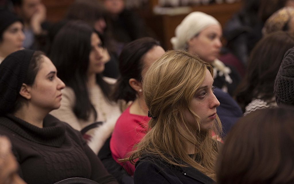 Women listen at an Amudim awareness event about the risks of sexual abuse and addiction. (Courtesy Amudim)