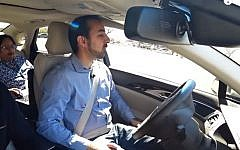 An Intel Corp./Mobileye self-driving car with a human driver behind the steering wheel (YouTube screenshot)