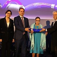 From left to right: Former Supreme Court Judges Miriam Naor and Esther Hayut; co-founder and chairman of Genesis Prize Foundation Stan Polovets; Supreme Court Justice and Genesis Lifetime Achievement Award Honoree, Justice Ruth Bader Ginsburg; and former presidents of Israeli Supreme Court Aaron Barak and Dorit Beinich, at the Genesis Award ceremony in Tel Aviv, July 4, 2018. (Eran Lamm/Lens Productions)