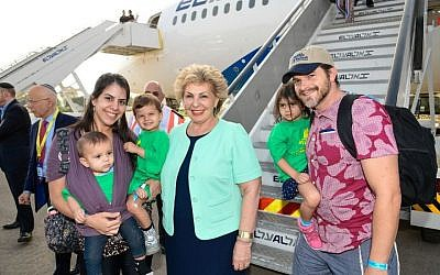 The Leopold family of Las Vegas meets Israel's minister of aliyah and integration, Sofa Landver (c), after arriving on their aliyah charter flight with Nefesh B'Nefesh. (Shahar Azran)