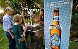 Guests taste the new German-Israel beer creation called '70' at the Herzliya residence of German Ambassador to Israel Clemens von Goetze, July 19, 2018 (Raphael Ahren/TOI)