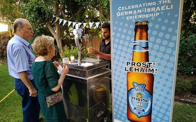 Guests taste the new German-Israel beer creation called '70' at the Herzliya residence of German Ambassador to Israel Clemens von Goetze, July 19, 2018 (Raphael Ahren/TOI)