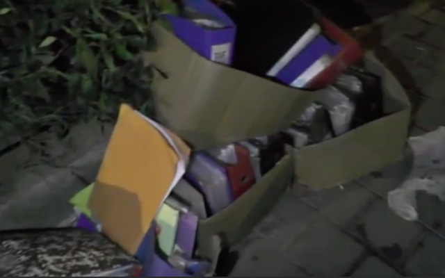 Files belonging to the Taf adoption agency containing personal information were found strewn outside an apartment building in Tel Aviv on July 6, 2018. (screen capture: Ynet)